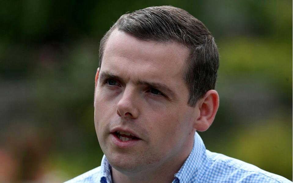 FILE PHOTO: Douglas Ross, newly announced Scottish Conservative leader, talks to media in Forres, Scotland, Britain August 5, 2020.  - Russell Cheyne/REUTERS