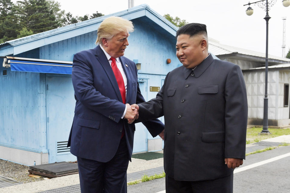 FILE - In this June 30, 2019, file photo, President Donald Trump shakes hands with North Korean leader Kim Jong Un at the border village of Panmunjom in the Demilitarized Zone, South Korea. There will be leaders and populations who shudder at the thought of four more years of the Donald Trump administration and those whose consternation is tied to his potential defeat, and a U.S. government led by a President Joe Biden. Trump had hoped his jaw dropping outreach to North Korea's Kim Jong Un would be his signature foreign policy legacy. (AP Photo/Susan Walsh, File)