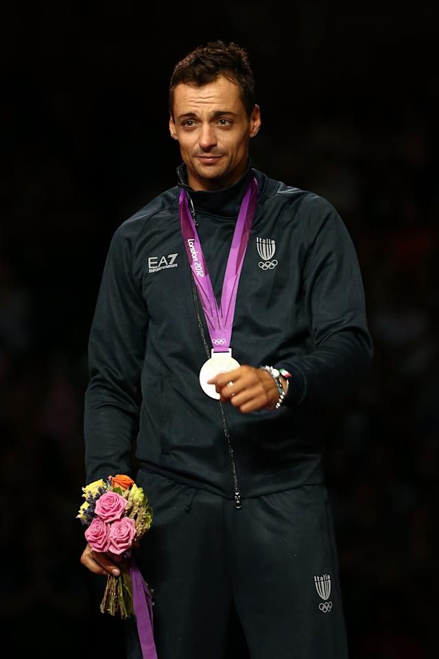 LONDON, ENGLAND - JULY 29:  (L-R) Silver medalist Diego Occhiuzzi of Italy poses on the podium during the medal ceremony for the Men's Sabre Individual on Day 2 of the London 2012 Olympic Games at ExCeL on July 29, 2012 in London, England.  (Photo by Quinn Rooney/Getty Images)