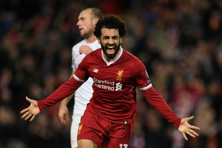 Liverpool's Egyptian midfielder Mohamed Salah celebrates after scoring their seventh goal during the UEFA Champions League Group E football match against Spartak Moscow December 6, 2017