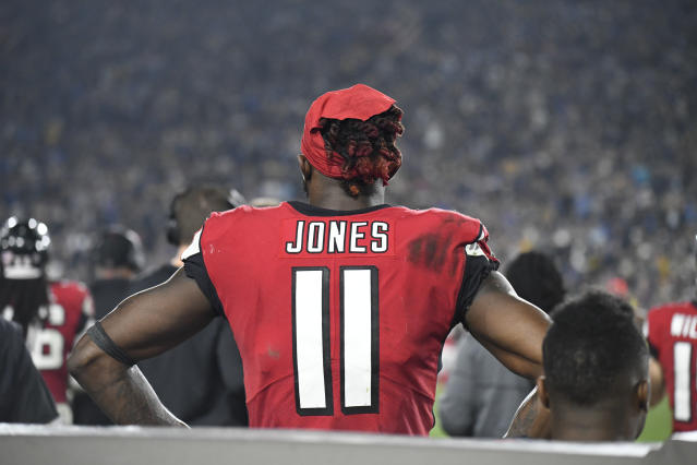 Falcons receiver Julio Jones reportedly won't report to training camp with his teammates on Thursday. (AP)