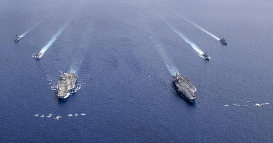 Aircraft from Carrier Air Wings 5 and 17 fly in formation over the Nimitz Carrier Strike Force, in the South China Sea on July 6. Photo: EPA-EFE