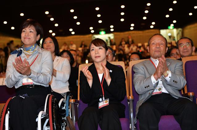 TOKYO, JAPAN - SEPTEMBER 07: Former Olympic athletes Hiromi Miyake (C) and Yoshiyuki Miyake (R) cheer in support of Tokyo's bid for the 2020 Summer Olympic Games, during the viewing of 2020 Summer Olympic Games host city announcement at Tosho Hall on September 7, 2013 in Tokyo, Japan. (Photo by Atsushi Tomura/Getty Images)