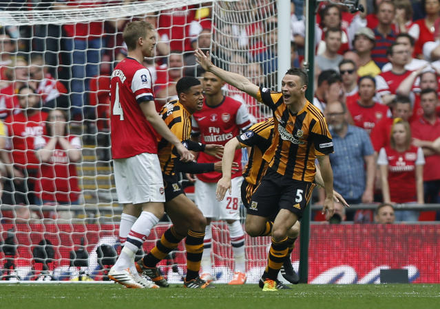 Hull City's James Chester, right, celebrates his goal against Arsenal during their English FA Cup final soccer match at Wembley Stadium in London, Saturday, May 17, 2014. (AP Photo/Sang Tan)