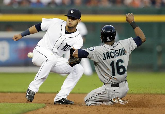 Detroit Tigers shortstop Eugenio Suarez waits on the throw before tagging out Seattle Mariners' Austin Jackson during a steal attempt in the fourth inning of a baseball game, Friday, Aug. 15, 2014 in Detroit. (AP Photo/Carlos Osorio)