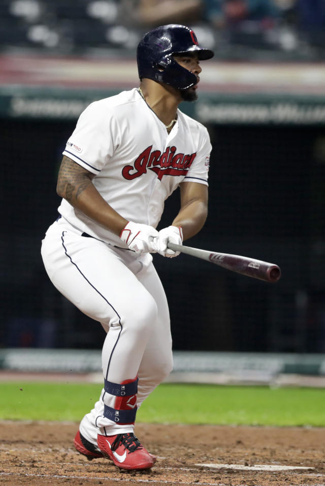 Cleveland Indians' Bobby Bradley watches his ball after hitting a one-run double in the sixth inning in a baseball game against the Kansas City Royals, Monday, June 24, 2019, in Cleveland. Jose Ramirez scored on the play. (AP Photo/Tony Dejak)