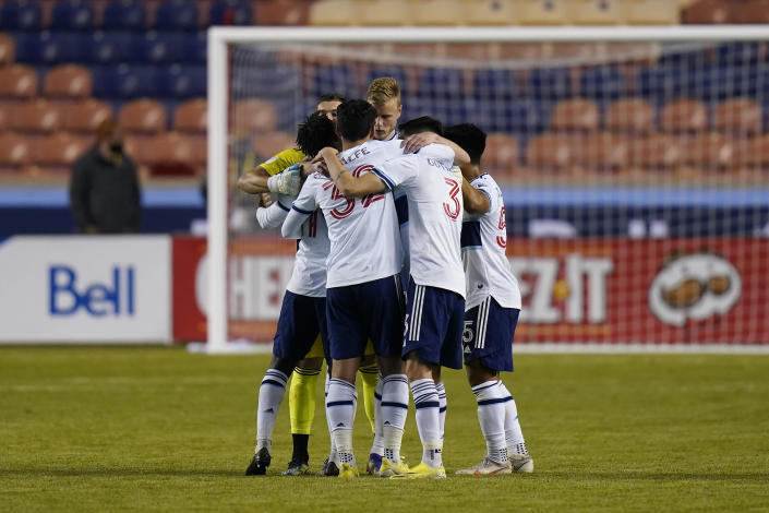 Vancouver Whitecaps players celebrate their victory over the Portland Timbers following their MLS soccer game, Sunday, April 18, 2021, in Sandy, Utah. (AP Photo/Rick Bowmer)