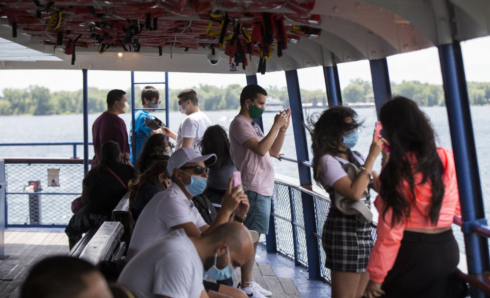 TORONTO, June 27, 2020 -- Passengers wearing face masks are seen on a ferry in Toronto, Canada, on June 27, 2020. Ferry service to the Toronto Islands resumed for the public starting on Saturday, with passengers required to wear face masks or coverings. (Photo by Zou Zheng/Xinhua via Getty) (Xinhua/Zou Zheng via Getty Images)