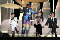 Jury president Spike Lee, second from left, almost announces 'Titane' as the winner of the Palme d'Or for the second time as fellow jury members Tahar Rahim, from bottom left, Melanie Laurent, and Song Kang-ho look on during the awards ceremony at the 74th international film festival, Cannes, southern France, Saturday, July 17, 2021. (AP Photo/Vadim Ghirda)