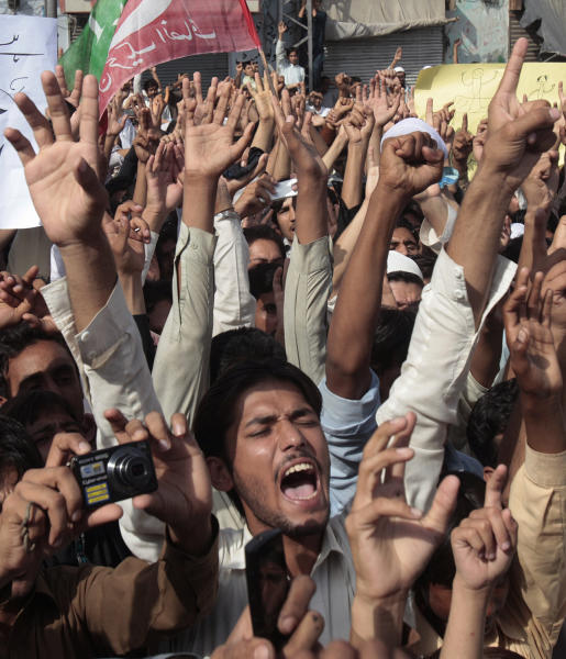 Supporters of a Pakistani Tehreek-e-Insaf or Movement for Justice chant slogans during a demonstration in Peshawar, Pakistan, Sunday, Sept. 16, 2012, as part of widespread anger across the Muslim world about a film ridiculing Islam's Prophet Muhammad. (AP Photo/Muhammad Sajjad)
