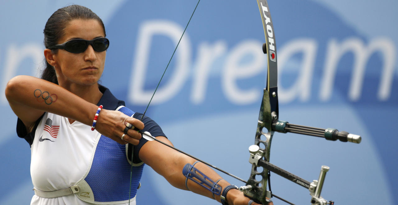 Khatuna Lorig, of the U.S., prepares to shoot an arrow during the women's individual archery competition at the Beijing 2008 Olympics in Beijing, Thursday, Aug. 14, 2008.  (AP Photo/Saurabh Das )