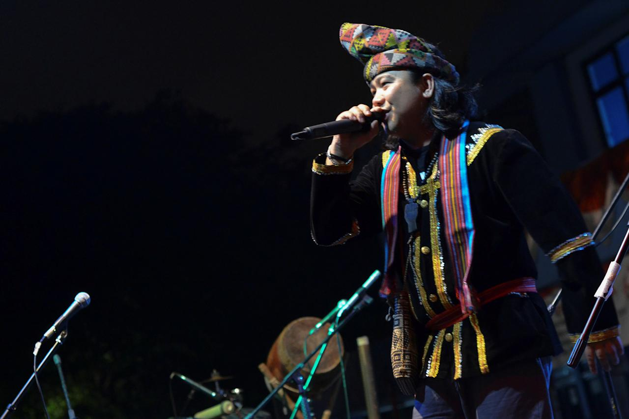 Malaysian indigenous musician Atama Katama or Andrew Ambrose, who spent a decade through the 1990s DJ-ing hip hop at clubs across Malaysia and other Southeast Asian cities, performs during a concert at the Jakarta Cultural Centre, in Jakarta, Indonesia, August, 31, 2014. Picture taken August 31, 2014. To match Feature MALAYSIA-LANDRIGHTS/MUSIC Thomson Reuters Foundation/Chris Zai