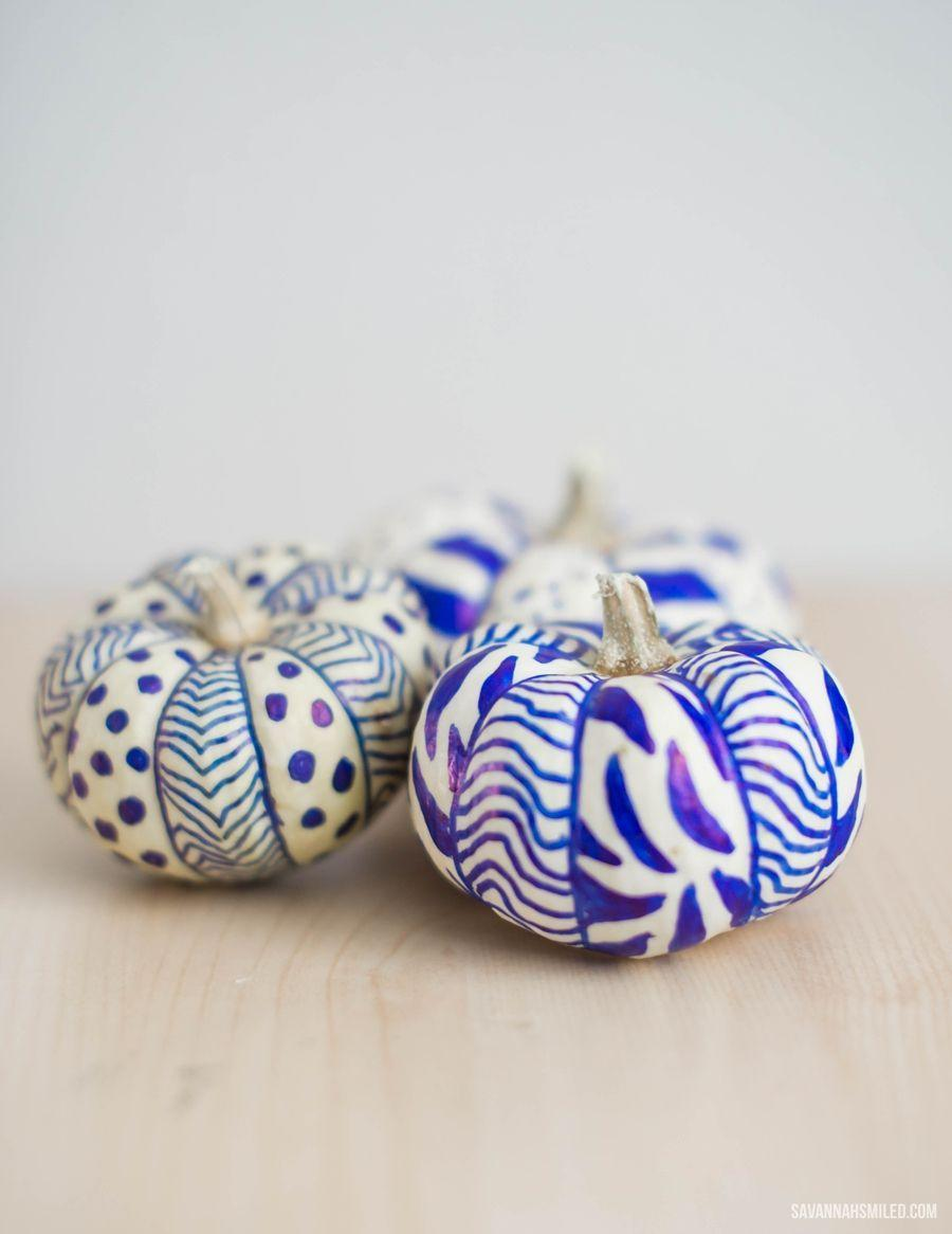 """<p>There's no need to whip out all of your crafting supplies to create a piece of truly unique pumpkin décor. Permanent markers are all you need to give these tiny gourds a makeover.</p><p><strong>Get the tutorial at <a href=""""http://www.savannahsmiled.com/blog/2014/10/diy-simple-doodle-sharpie-pumpkinshtml"""" rel=""""nofollow noopener"""" target=""""_blank"""" data-ylk=""""slk:Savannah Smiled"""" class=""""link rapid-noclick-resp"""">Savannah Smiled</a>.</strong></p><p><strong><strong><strong><strong><strong><strong><strong><strong><strong><strong><strong><strong><strong><a class=""""link rapid-noclick-resp"""" href=""""https://go.redirectingat.com?id=74968X1596630&url=https%3A%2F%2Fwww.walmart.com%2Fsearch%2F%3Fquery%3Dpermanent%2Bmarkers&sref=https%3A%2F%2Fwww.thepioneerwoman.com%2Fhome-lifestyle%2Fdecorating-ideas%2Fg36664123%2Fwhite-pumpkin-decor-ideas%2F"""" rel=""""nofollow noopener"""" target=""""_blank"""" data-ylk=""""slk:SHOP PERMANENT MARKERS"""">SHOP PERMANENT MARKERS</a></strong></strong></strong></strong></strong></strong></strong></strong></strong></strong></strong></strong><br></strong></p>"""