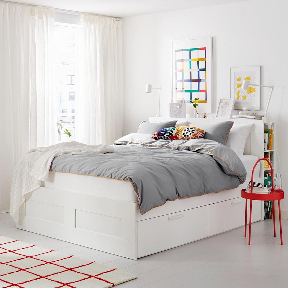 <p>Not only does the <span>Brimnes Bed </span> ($379, originally $399) have accessible drawers underneath, but its headboard hides a shelving unit, too!</p>