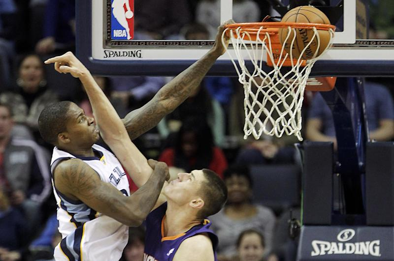 Memphis Grizzlies forward Ed Davis (32) dunks the ball over Phoenix Suns center Alex Len, right, in the first half of an NBA basketball game, Friday, Jan. 10, 2014, in Memphis, Tenn