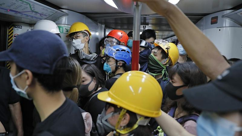 Protesters in Hong Kong have blocked platform doors to prevent trains from leaving stations