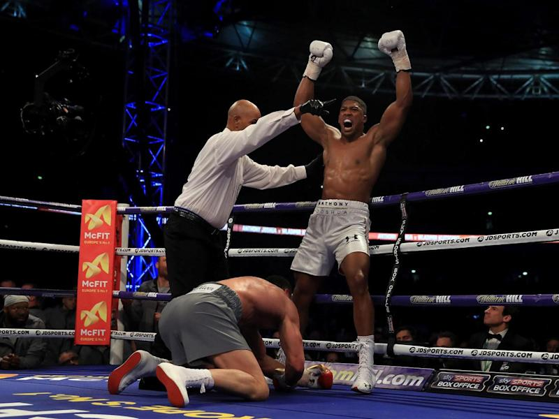 Joshua celebrates his victory above the fallen Klitschko (Getty)