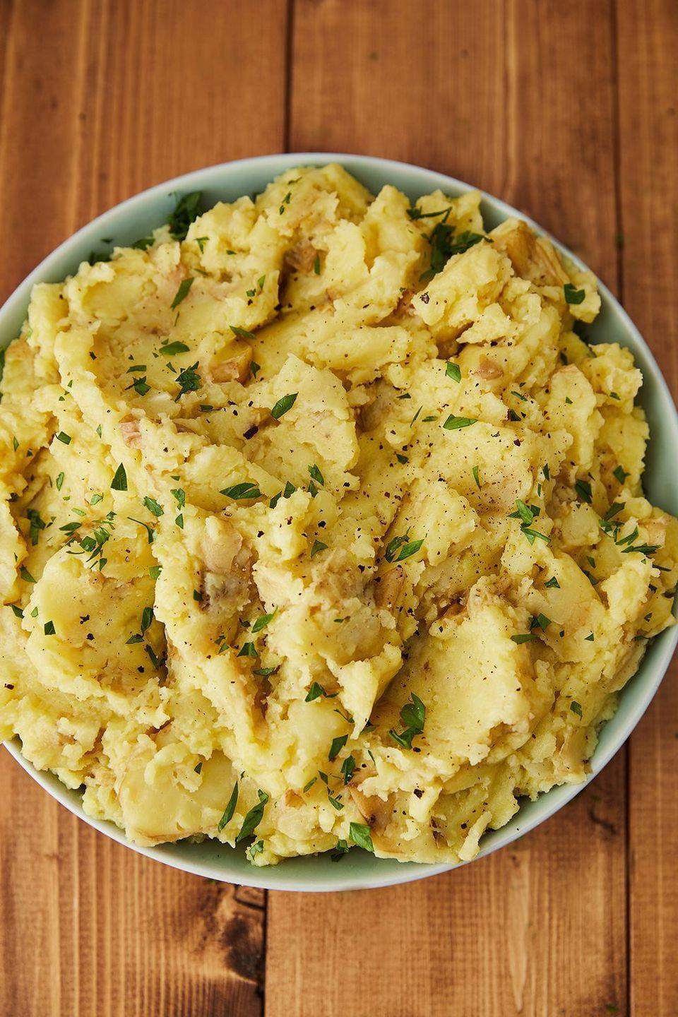 "<p>Vegan butter is your friend. </p><p>Get the recipe from <a href=""https://www.delish.com/holiday-recipes/thanksgiving/a22657761/best-vegan-mashed-potatoes-recipe/"" rel=""nofollow noopener"" target=""_blank"" data-ylk=""slk:Delish"" class=""link rapid-noclick-resp"">Delish</a>.</p>"