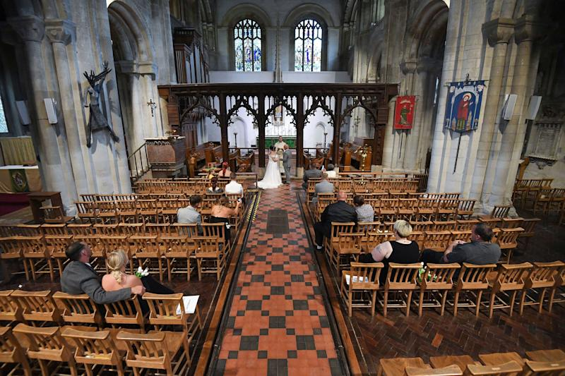 <strong>Tina-Lynn Birch and Billy Bryant get married inside the Priory Church of St Peter, as weddings were permitted to take place in the country with ceremonies capped at a maximum of 30 guests, in Dunstable, England, Saturday July 4.</strong> (Photo: ASSOCIATED PRESS)