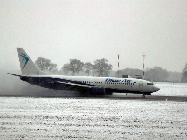 A Blue Air flight comes into land at Luton Airport (Steve Parsons/PA)