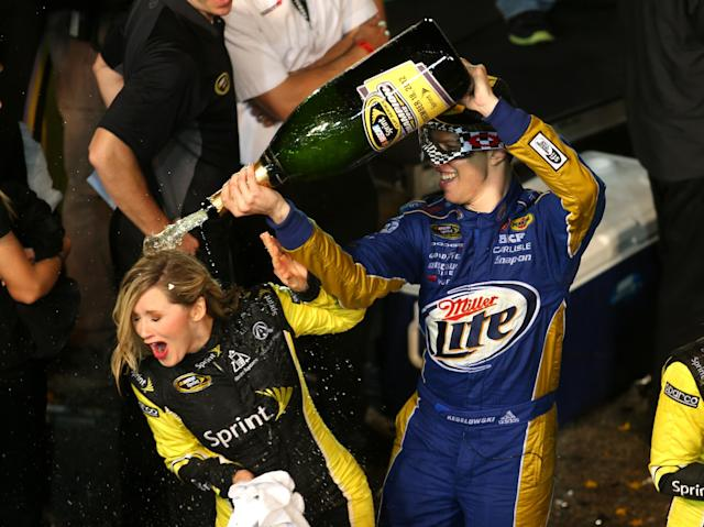 HOMESTEAD, FL - NOVEMBER 18: Brad Keselowski, driver of the #2 Miller Lite Dodge, celebrates in Champion Victory Lane after winning the series championship and finishing in fifteenth place for the NASCAR Sprint Cup Series Ford EcoBoost 400 at Homestead-Miami Speedway on November 18, 2012 in Homestead, Florida. (Photo by Todd Warshaw/Getty Images)
