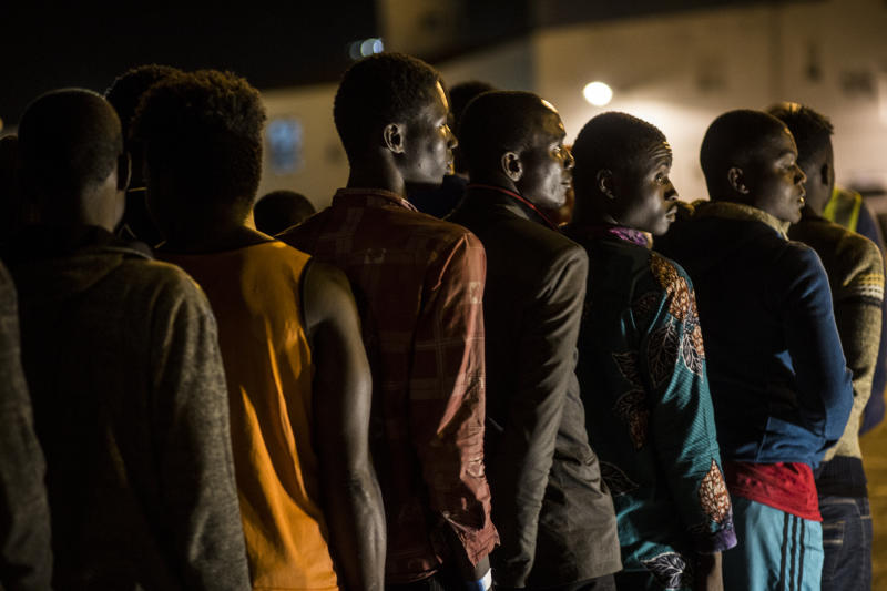Migrants disembark at Motril port after they were rescued by Spanish NGO ProActiva Open Arms at Alboran Sea, about 40 miles (64 km) from Spanish coasts, on Thursday, Oct. 11, 2018. The Open Arms is now based at Motril port in Spain, in order to start operating in the western Mediterranean area. (AP Photo/Javier Fergo)