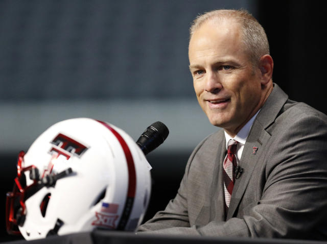 FILE - In this July 15, 2019, photo, Texas Tech head coach Matt Wells speaks on the first day of the Big 12 Conference NCAA college football media days in Arlington, Texas. New Kansas State coach Chris Klieman has seven championship rings, all at the FCS level. Texas Techs Matt Wells is coming off a successful stretch at his alma mater in the Mountain West Conference. Their Big 12 debuts will be their first games as head coach of a Power Five team.(AP Photo/David Kent, file)