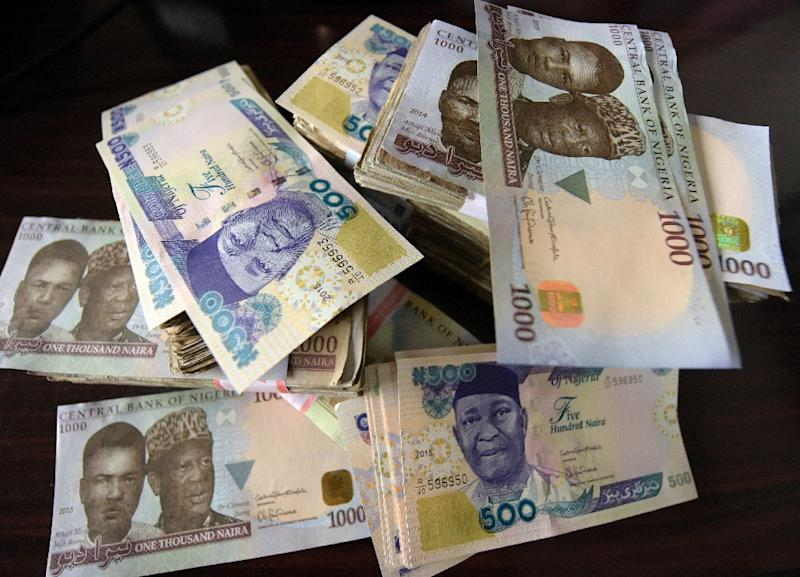"""Nigerian President Muhammadu Buhari took six months to name a finance minister, then vowed not to """"kill the naira"""" by devaluing it, against expert advice (AFP Photo/Pius Utomi Ekpei)"""