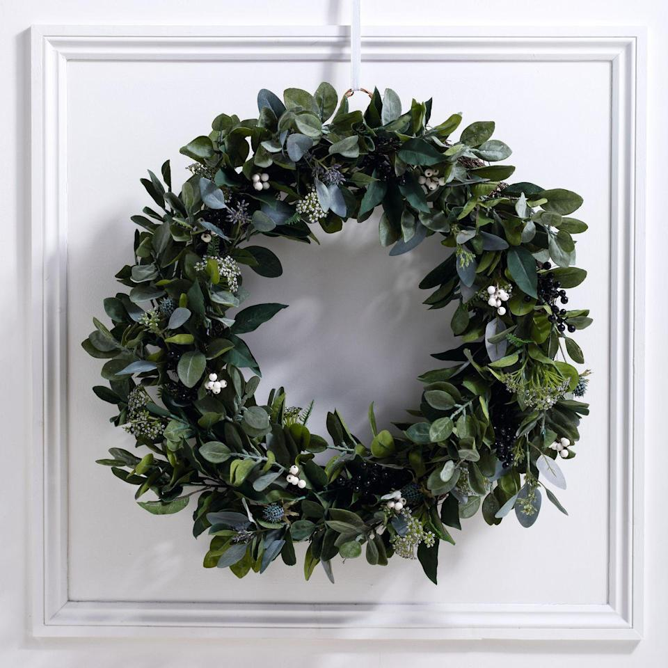 "<p>Realistic faux greenery ensures that this statement wreath can be enjoyed for years to come. A combination of mixed leaves, sea holly and berries create a neutral look for pared-back festive partiers. From £135, <a href=""https://www.thewhitecompany.com/uk/Ultimate-Green-and-Berry-Wreath---70cm/p/WGHUB?swatch=Natural"" rel=""nofollow noopener"" target=""_blank"" data-ylk=""slk:thewhitecompany.com"" class=""link rapid-noclick-resp"">thewhitecompany.com</a></p>"
