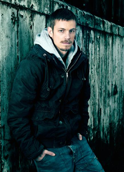 """This undated publicity image released by AMC shows Joel Kinnaman, who portrays Seattle Police detective Stephen Holder in the series """"The Killing."""" On the season finale, which airs Sunday at 9 p.m. EDT, Holder and Detective Sarah Linden, played by Mireille Enos will finally crack the case. That's not a moment too soon for restless viewers, some of whom were counting on the Big Reveal a year ago but got a cliffhanger instead.(AP Photo/AMC, Frank Ockenfels)"""