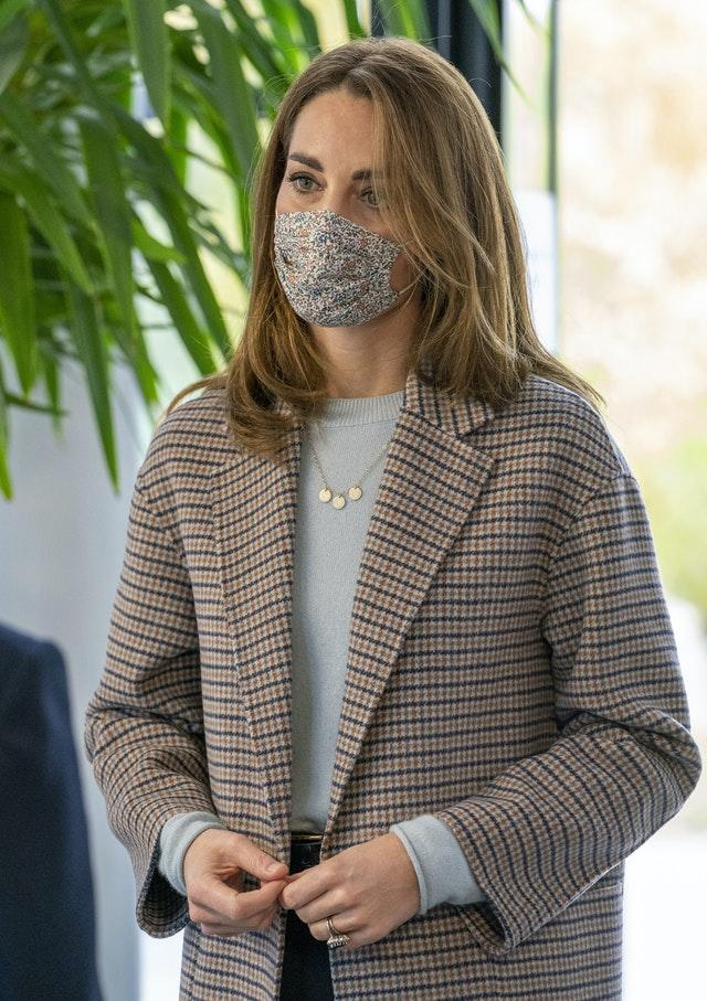 Kate wore a face mask for a visit to the university. Arthur Edwards/The Sun