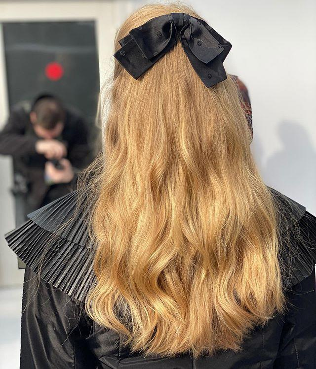 """<p>Who says romance is dead? At Chanel, the dreamy half-up hairstyles were adorned with oversize black bows. </p><p><a href=""""https://www.instagram.com/p/B9RNPnTHSQF/"""" rel=""""nofollow noopener"""" target=""""_blank"""" data-ylk=""""slk:See the original post on Instagram"""" class=""""link rapid-noclick-resp"""">See the original post on Instagram</a></p>"""