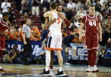 Mar 24, 2019; Columbia, SC, USA; Virginia Cavaliers guard Kyle Guy (5) and Oklahoma Sooners guard Miles Reynolds (3) embrace after the second round of the 2019 NCAA Tournament at Colonial Life Arena. Mandatory Credit: Jeff Blake-USA TODAY Sports