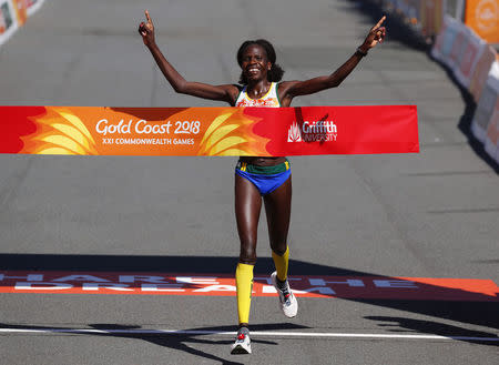 Athletics - Gold Coast 2018 Commonwealth Games - Women's Marathon Final - Southport Broadwater Parklands - Gold Coast, Australia - April 15, 2018. Helalia Johannes of Namibia crosses the finish line to win the gold. REUTERS/David Gray