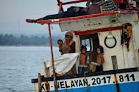 Nemah Shah believed his wife and daughter had died at sea, until he saw pictures online of them arriving in Indonesia