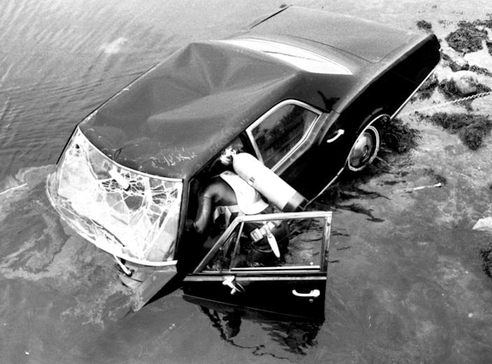 A frogman attempts to raise a car eight hours after it plunged into a pond with Sen. Edward Kennedy behind the wheel, on July 19, 1969, on Chappaquiddick Island, Mass. Mary Jo Kopechne was killed in the crash. Kennedy pleaded guilty to leaving the scene of an accident and received a suspended two-month jail sentence. (Photo: Bettmann/Getty Images)