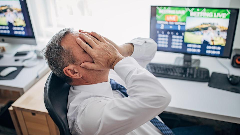 One senior business man live betting at his home office and lose game.