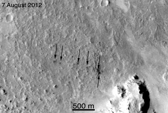 This image from NASA's Mars Reconnaissance Orbiter shows the six craters created by the ejection of tungsten slugs during the Curiosity Mars rover's landing on Aug. 5, 2012.