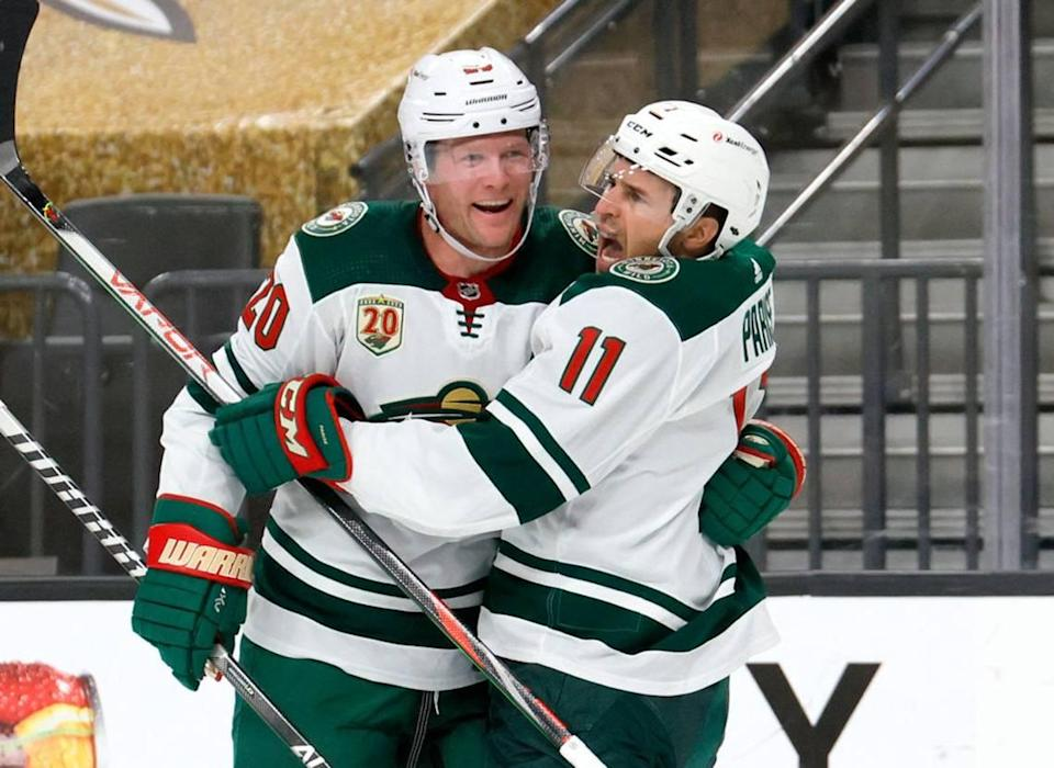 Ryan Suter #20 and Zach Parise #11 of the Minnesota Wild celebrate after Suter assisted Parise on a first-period goal against the Vegas Golden Knights in Game Seven of the First Round of the 2021 Stanley Cup Playoffs at T-Mobile Arena on May 28, 2021 in Las Vegas, Nevada. (Ethan Miller/Getty Images/TNS)