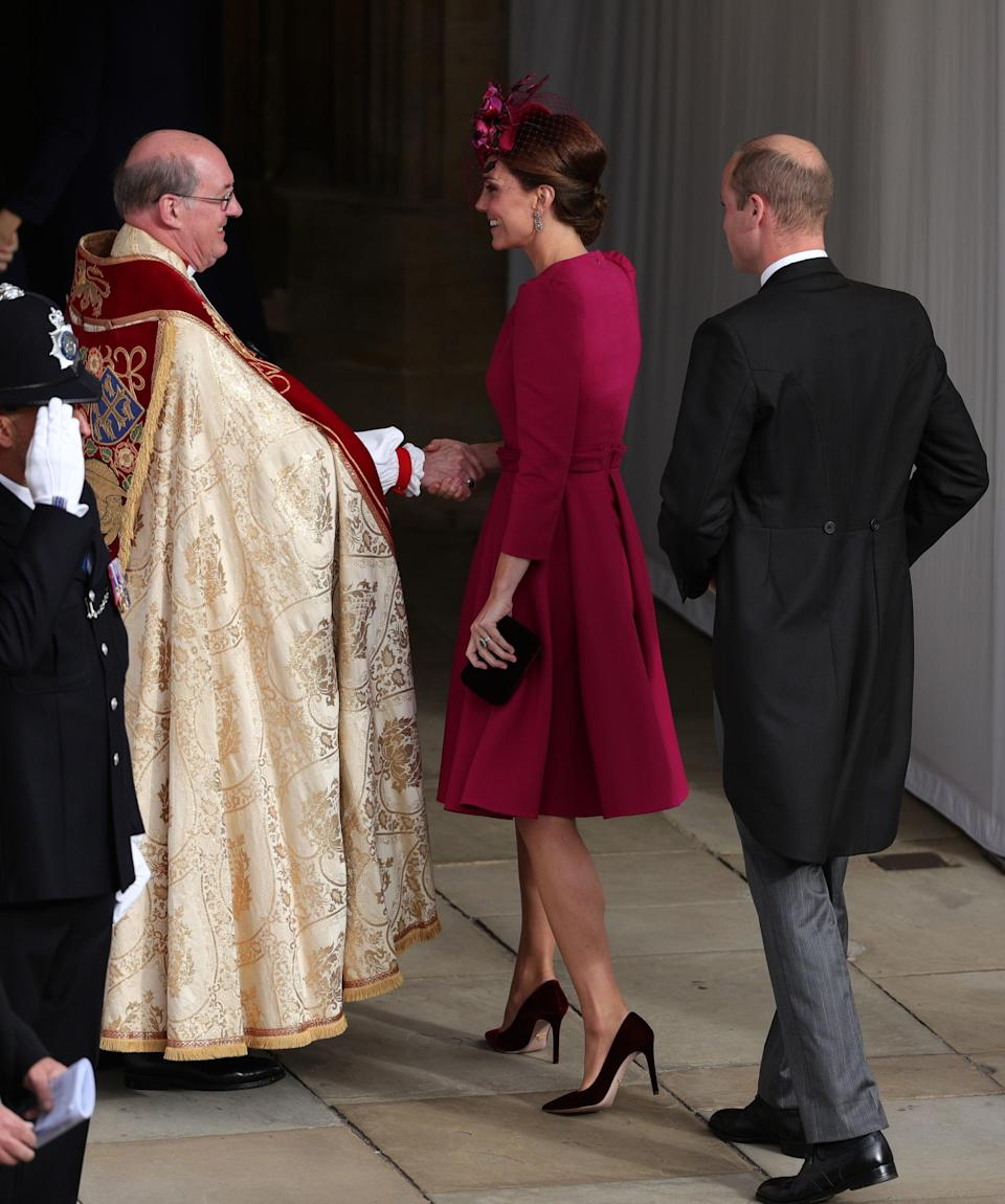 Kate chose a berry coat dress for the wedding [Photo: PA]