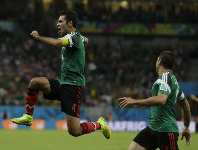 Mexico's Rafael Marquez celebrates after scoring the first goal of his team during the group A World Cup soccer match between Croatia and Mexico at the Arena Pernambuco in Recife, Brazil, Monday, June 23, 2014. Mexico won 3-1.(AP Photo/Ricardo Mazalan)