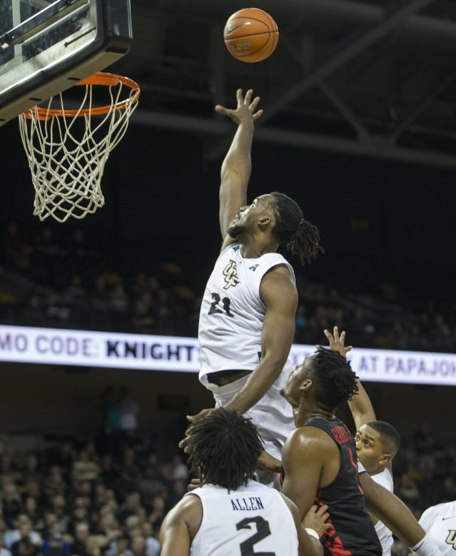 Central Florida forward Chad Brown (21) attempts to block a shot during the first half of an NCAA college basketball game against Houston in Orlando, Fla., Thursday, Feb. 7, 2019. (AP Photo/Willie J. Allen Jr.)