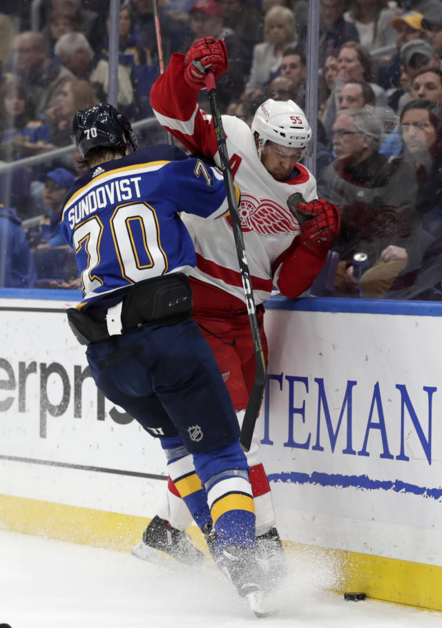 St. Louis Blues' Oskar Sundqvist (70) slams into Detroit Red Wings' Niklas Kronwall (55) in the second period of an NHL hockey game, Thursday, March 21, 2019, in St. Louis. (AP Photo/Tom Gannam)