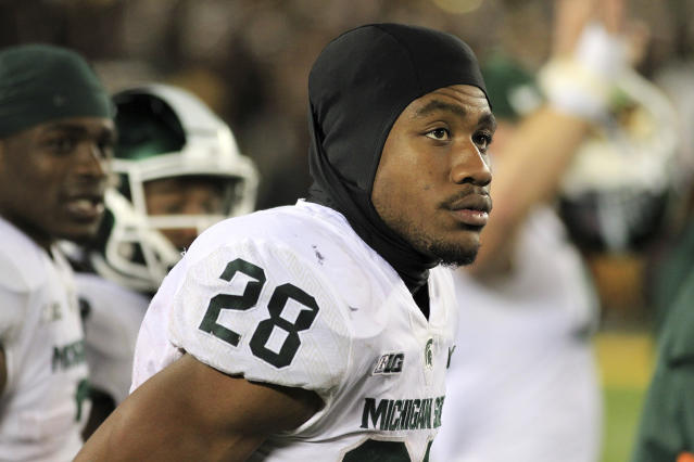 Michigan State running back Madre London (28) watches from the sideline against Minnesota in the third quarter of an NCAA college football game Saturday, Oct. 14, 2017, in Minneapolis. Michigan State defeated Minnesota 30-27. (AP Photo/Andy Clayton-King)