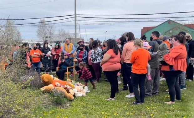 Dozens of people turned out, with only a few hours notice, in Happy Valley-Goose Bay on Monday to mourn after the remains of hundreds of children were found at the former Kamloops Indian Residential School. (Regan Burden/CBC - image credit)