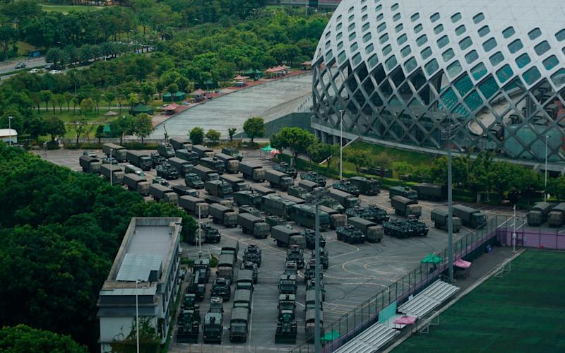Armored vehicles have been spotted in Shenzhen, a Chinese city bordering Hong Kong - AP