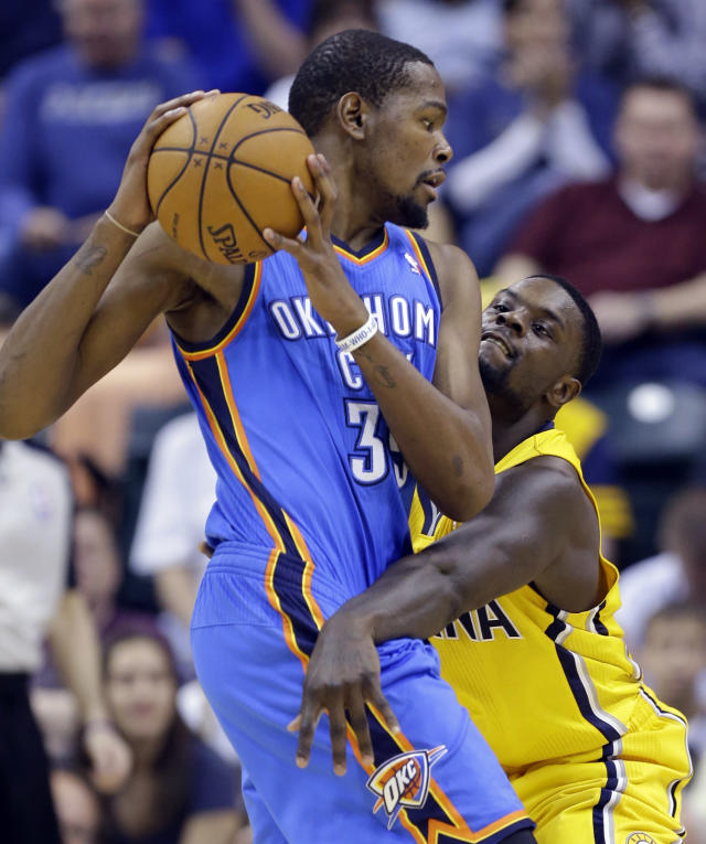 Indiana Pacers guard Lance Stephenson, right, defends against Oklahoma City Thunder forward Kevin Durant in the second half of an NBA basketball game in Indianapolis, Sunday, April 13, 2014. The Pacers defeated the Thunder 102-97. (AP Photo/Michael Conroy)