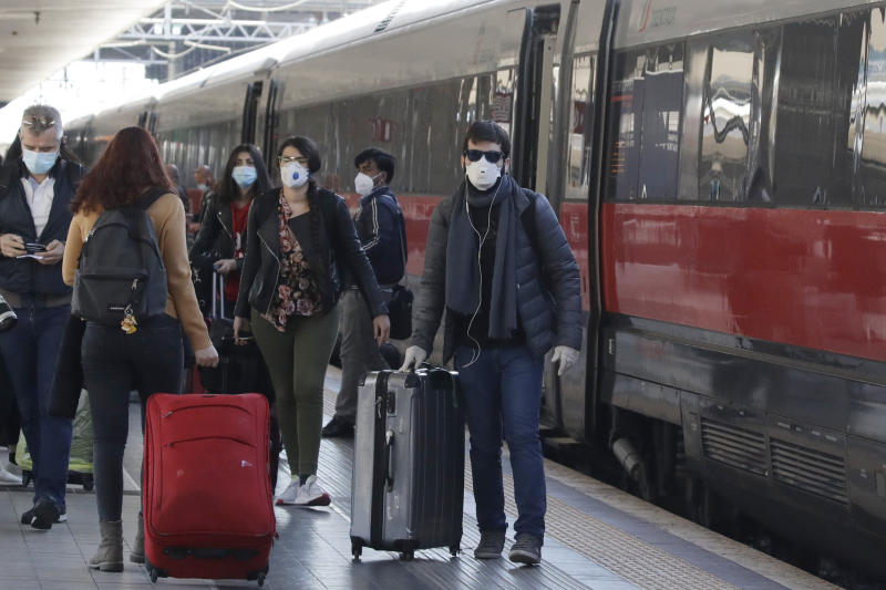 People with the train from Milan arrive at Termini station in Rome, Monday, May 4, 2020. Italy began stirring again Monday after a two-month coronavirus shutdown, with 4.4 million Italians able to return to work and restrictions on movement eased in the first European country to lock down in a bid to stem COVID-19 infections. (AP Photo/Alessandra Tarantino)