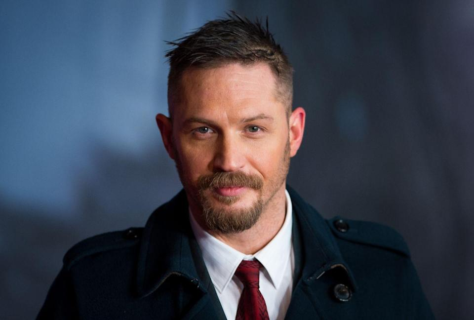 """<p>Tom Hardy hasn't kept his <a href=""""http://www.bbc.co.uk/newsbeat/article/14932570/tom-hardy-admits-he-had-a-recording-deal-as-a-rapper"""" rel=""""nofollow noopener"""" target=""""_blank"""" data-ylk=""""slk:unreleased rap album"""" class=""""link rapid-noclick-resp"""">unreleased rap album</a> a secret, per se, but he also didn't help fans find the gem. Thanks to the internet (specifically, Reddit), Tom's mixtape, <a href=""""https://youtu.be/JAqQ8Myx-1c"""" rel=""""nofollow noopener"""" target=""""_blank"""" data-ylk=""""slk:Falling on Your Arse in 1999"""" class=""""link rapid-noclick-resp""""><em>Falling on Your Arse in 1999</em></a>, was <a href=""""https://www.vice.com/en_us/article/59wa3d/tom-hardys-rap-mixtape-from-1999-is-actually-kind-of-fire"""" rel=""""nofollow noopener"""" target=""""_blank"""" data-ylk=""""slk:unearthed in 2018"""" class=""""link rapid-noclick-resp"""">unearthed in 2018</a>. Tom, who went by Tommy No. 1, teamed up with DJ Eddie Too Tall for some perfect '90s rap.</p>"""