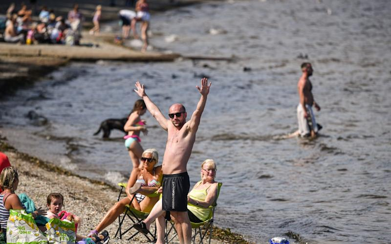 Sunbathers enjoyed the warm weather in Luss, Argyle and Bute - Getty/Jeff J Mitchell